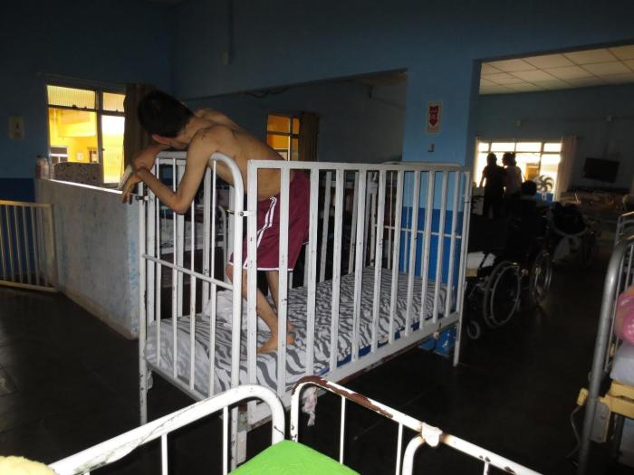 In many institutions, staff use beds with high bars to confine persons with disabilities.