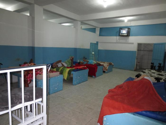 A room for 10 people in an institution for adults and children in Rio de Janeiro. Residents had little or no privacy and no personal belongings.