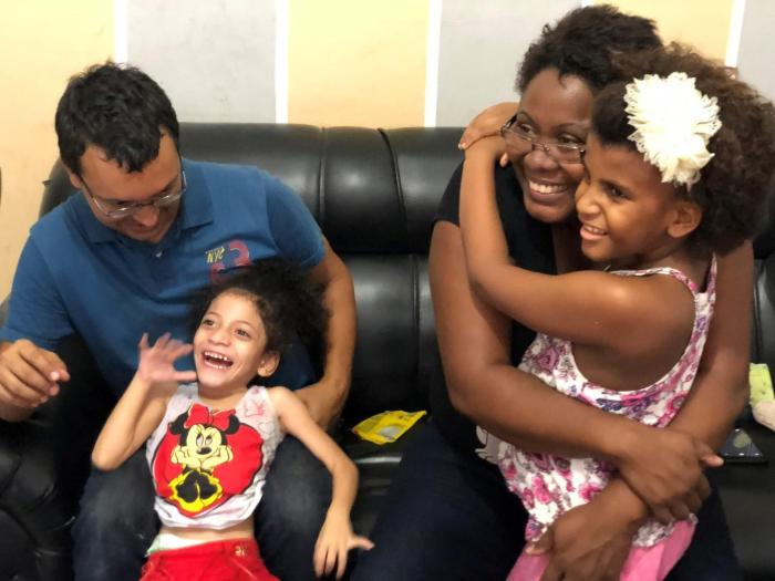 "Neiva Correa Marins and Carlos Eduardo Cruz are a couple from Rio de Janeiro who adopted Silvana and Sofia, ages 3 and 4, two girls with intellectual disabilities in 2016. ""They started to thrive when we took them to our home,"" Correa Marins said."