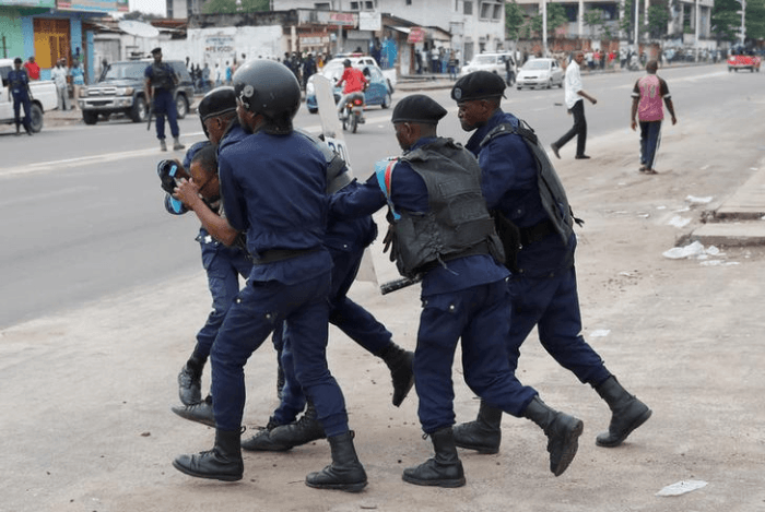 Police detain a protester during a peaceful march after Sunday Mass in front of the Notre Dame Cathedral in Kinshasa, Democratic Republic of Congo, February 25, 2018.