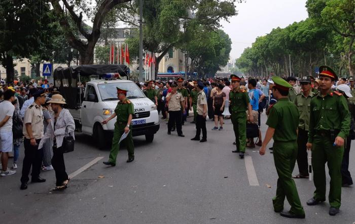 Police disperse a demonstration against a draft law on special economic zones in Hanoi, Vietnam, June 10, 2018.