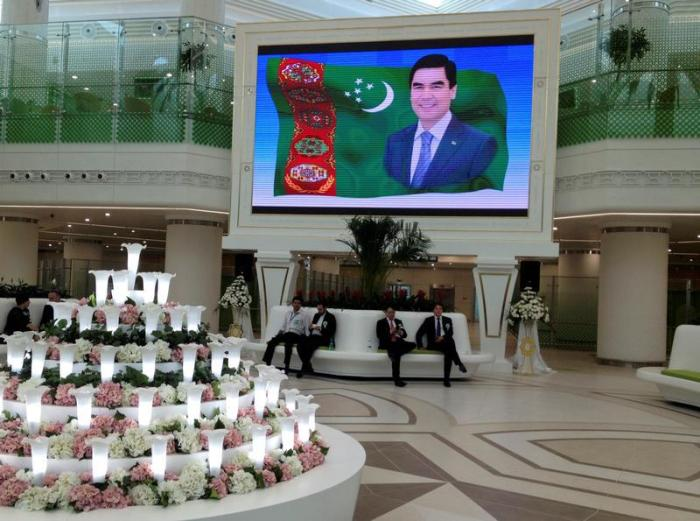 A screen showing a portrait of Turkmen President Kurbanguly Berdymukhamedov inside the terminal of the newly built airport in Ashgabat