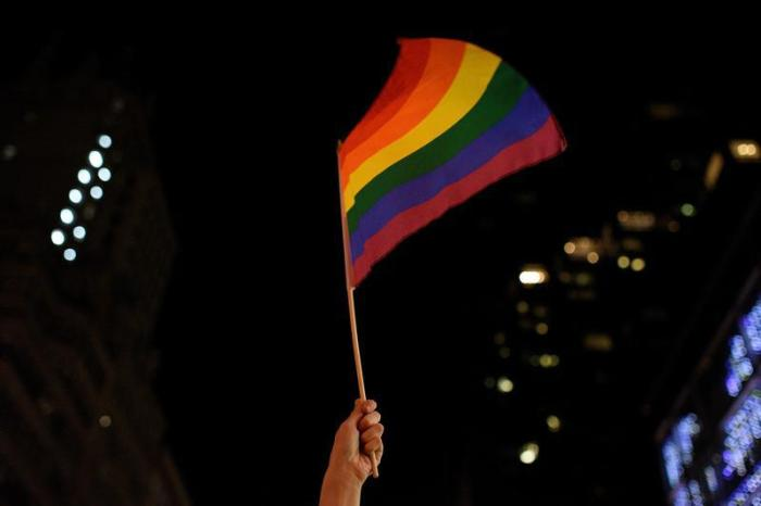 An activist waves a rainbow flag in Manhattan, New York, US, February 26, 2017.