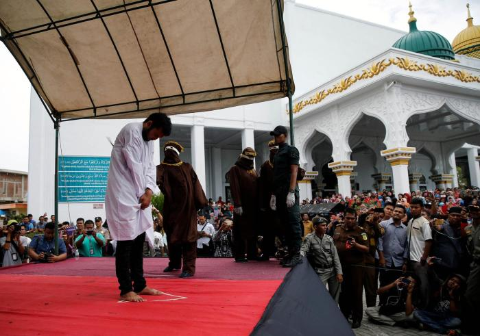 Local authorities publicly cane a man for having gay sex, in Banda Aceh, Aceh province, May 23, 2017.