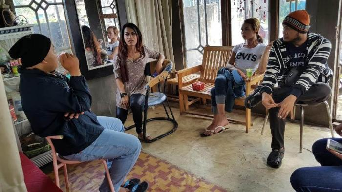 Transgender activists in Amuntai, South Kalimantan, discuss the increase in discrimination they face while distributing condoms. Photo by Andreas Harsono.