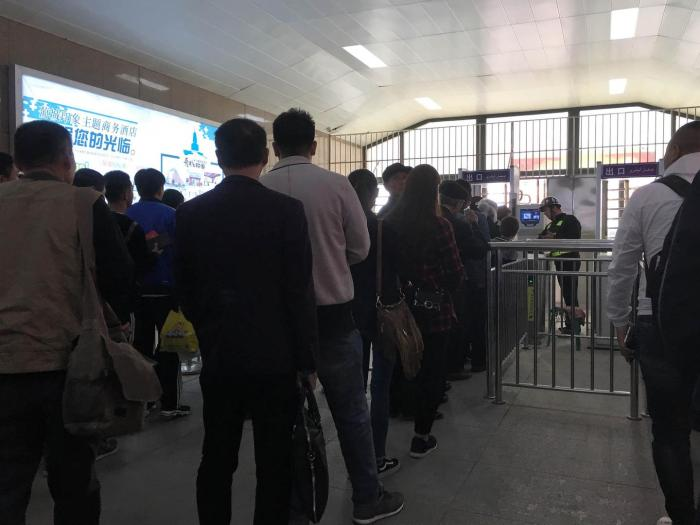 A checkpoint equipped with facial recognition in Turpan, Xinjiang. The photographer noted that police let Han through a fast lane without checking them while Turkic Muslims were in long lines waiting for a thorough security check.