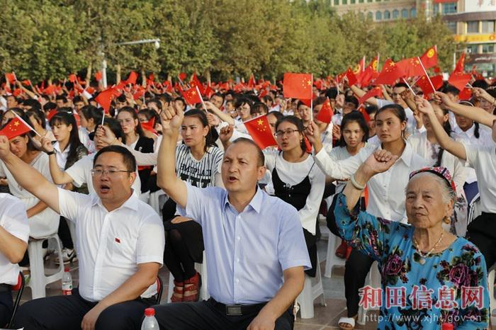 "People denounce the ""three evil forces"" in a mass political meeting in Hotan, Xinjiang."