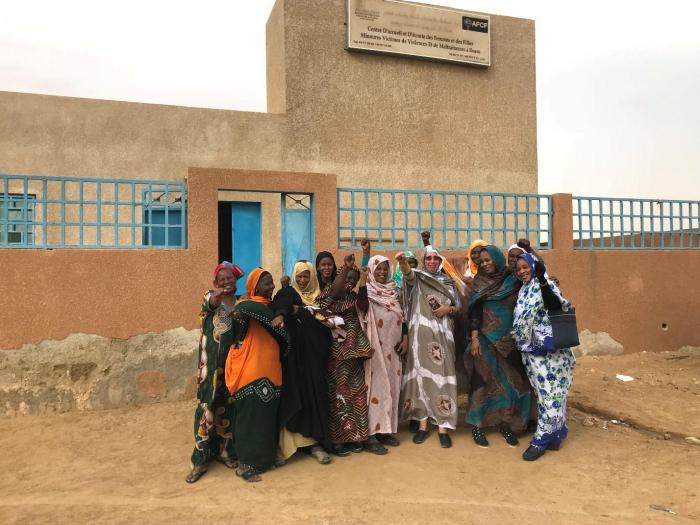 Aminetou Mint Ely [center, holding phone], president of the Association of Women Heads of Family and staff of a support center for survivors of gender-based violence, run by the association, Rosso, Mauritania, February 7, 2018.