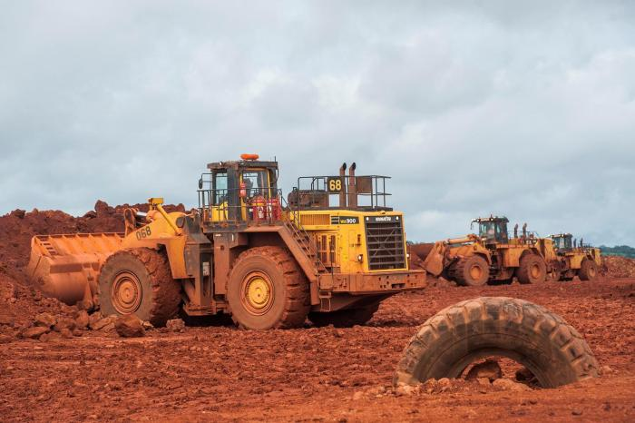 Bulldozers move bauxite at the Sangaredi mine operated by Compagnie des Bauxites de Guinée (CBG) near Boké, Guinea on September 8, 2015.