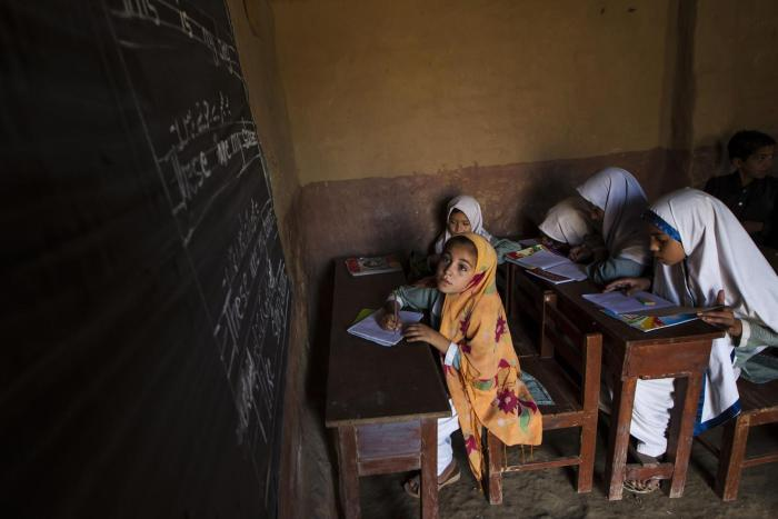 Girls attend lessons at a school on the outskirts of Islamabad.