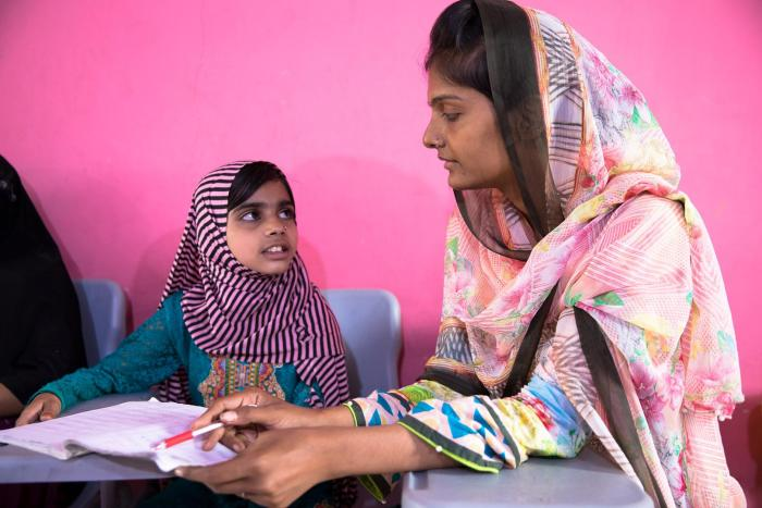 Laiba, age eight, with Shazia, the founder of the lyari School.