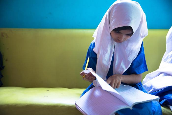Laiba, age eight, a student at the lyari School. laiba's older sister is not able to study at all because she is responsible for housework and caring for her younger siblings.