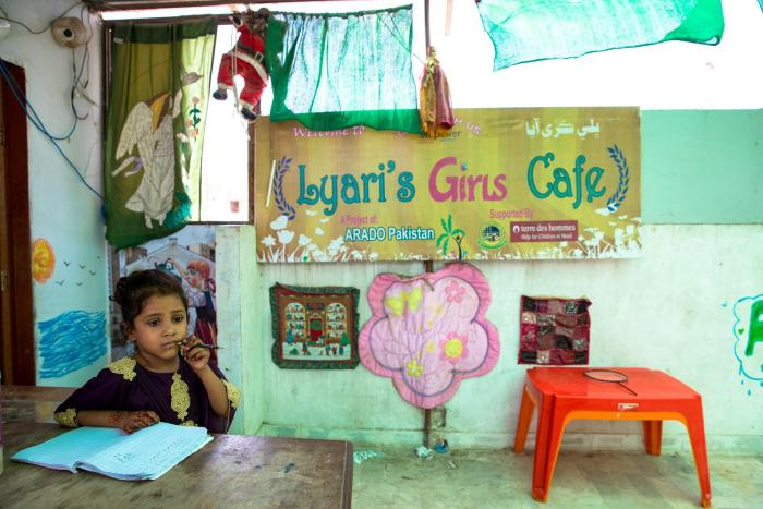 a girl studying at the lyari school.