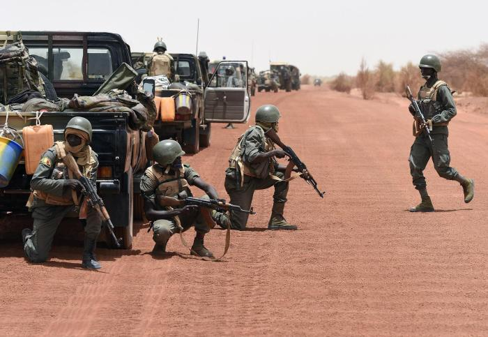 Malian army forces secure a road between Goundam and Timbuktu, northern Mali, on June 2, 2015, as part of a counterterrorism operation in the Sahel.