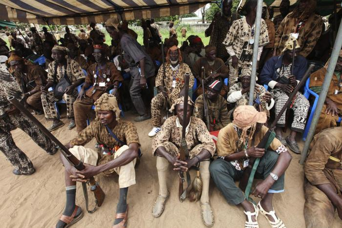 Members of the Dozo, a traditional hunters' society present in Mali, Cote d'Ivoire, and Burkina Faso, in Abobo, near Abidjan. The Dozo in Mali have been implicated in numerous serious abuses against Peuhl civilians, particularly near Djenné in central Mal