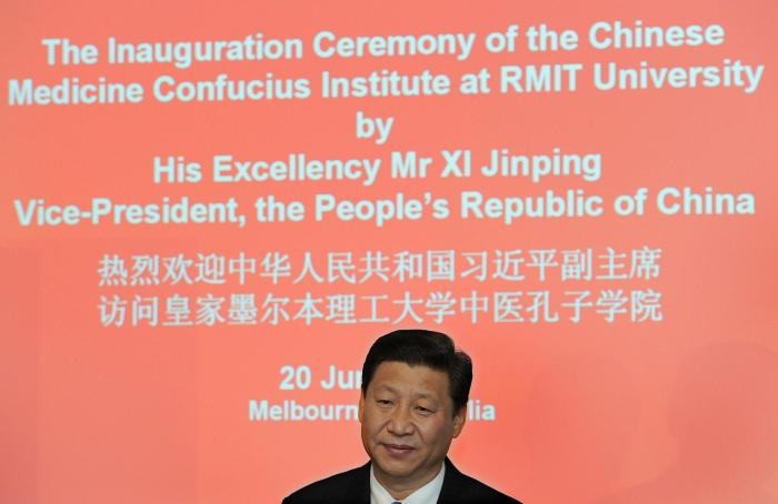 Then Chinese Vice President Xi Jinping makes a speech at the opening of Australia's first Chinese Medicine Confucius Institute, at the RMIT University in Melbourne on June 20, 2010.