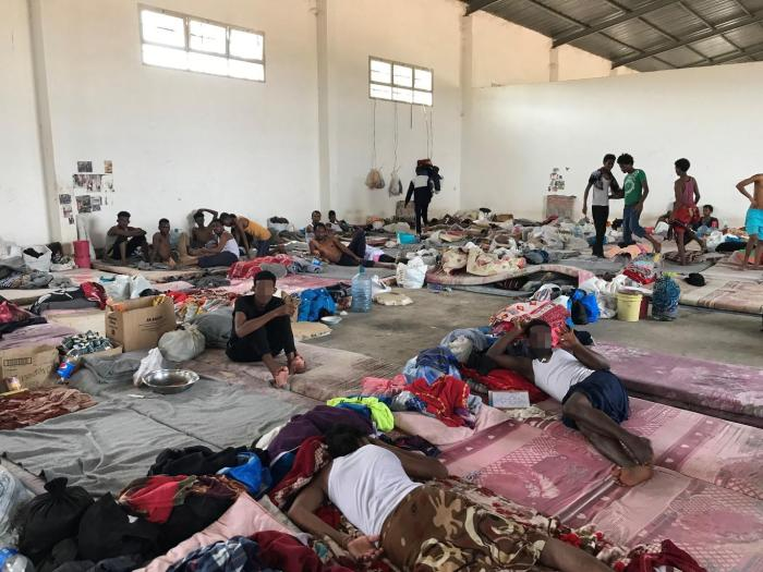 Men in one of the large hangar rooms at the Ain Zara detention center, Tripoli, July 5, 2018.