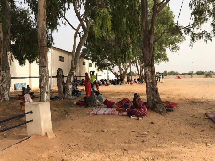 Women sit outside at Ain Zara detention center, Tripoli, July 5, 2018.