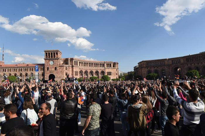 People celebrating Armenian prime -minister Serzh Sarkisyan's resignation after days of protests.