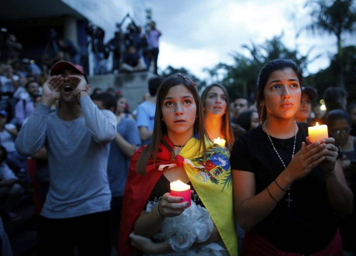 Anti-government protestors in Venezuela take to the streets for a candlelight vigil in honor of protesters killed in clashes with security forces.