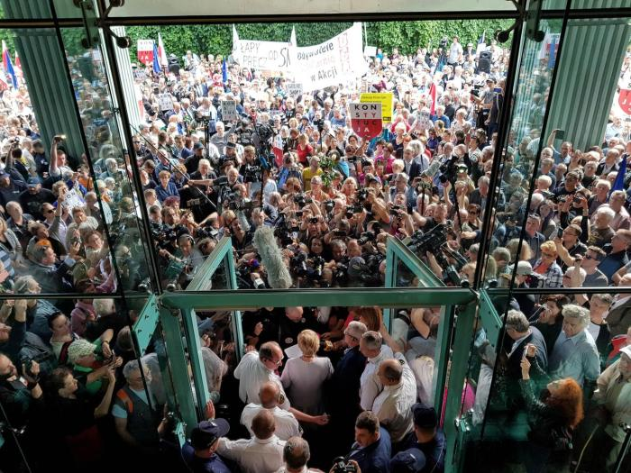 Supreme Court President Malgorzata Gersdorf addresses supporters and the media before entering the Supreme Court building in Warsaw, Poland, July 4, 2018.
