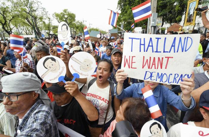 Protesters march near Thammasat University in Bangkok on May 22, 2018, the fourth anniversary of the Thai junta's 2014 coup, demanding that a general election be held this year. (
