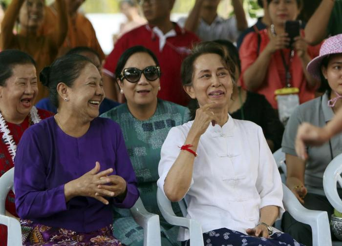 Myanmar's leader Aung San Suu Kyi, right, and first lady Cho Cho, left, smile as they take part in the first day of Myanmar traditional water festival, also known as Myanmar New Year, in Naypyitaw, Myanmar Saturday, April 13, 2019.