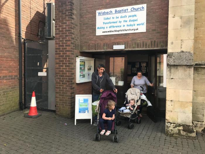 A couple and their two children leave the food bank in Wisbech, Cambridgeshire, after collecting a three day emergency supply of food, April 2019. They told Human Rights Watch the benefit cap left them unable to pay rent and afford food.