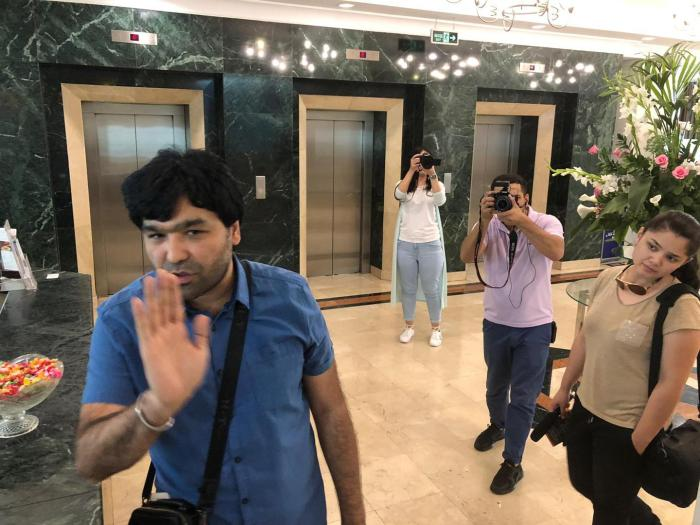 Video blogger Sardor Kamilov (left) accosts Human Rights Watch researcher Steve Swerdlow at a hotel in Tashkent, Uzbekistan, June 13, 2019.