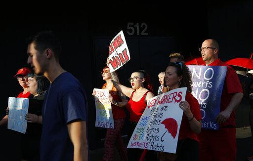 People march in support of sex workers, Sunday, June 2, 2019, in Las Vegas.