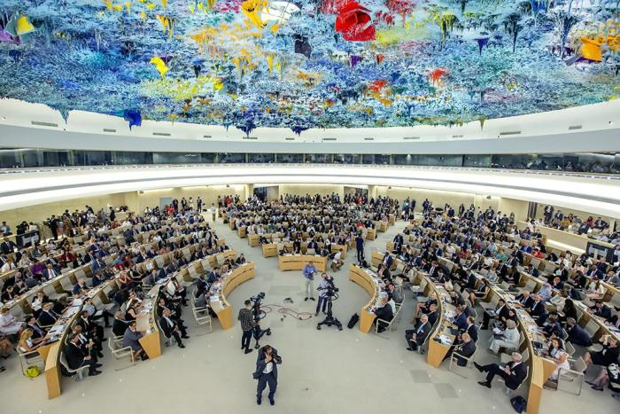Delegates sit at the opening of the 41th session of the Human Rights Council, at the European headquarters of the United Nations in Geneva, Switzerland, Monday, June 24, 2019.