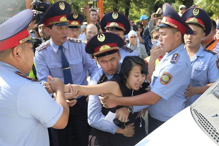 Kazakhstan police officers detain a protester during an opposition rally in Almaty, Kazakhstan.
