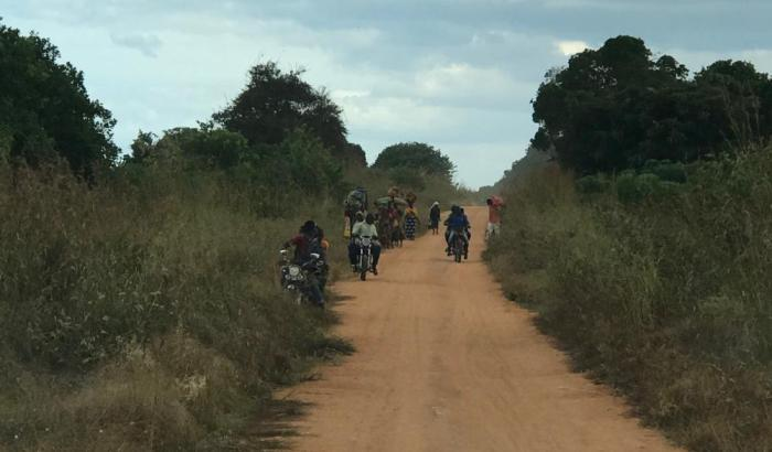 Residents of Naunde, in Macomia, Cabo Delgado, flee their village following an attack on June 5, 2018.