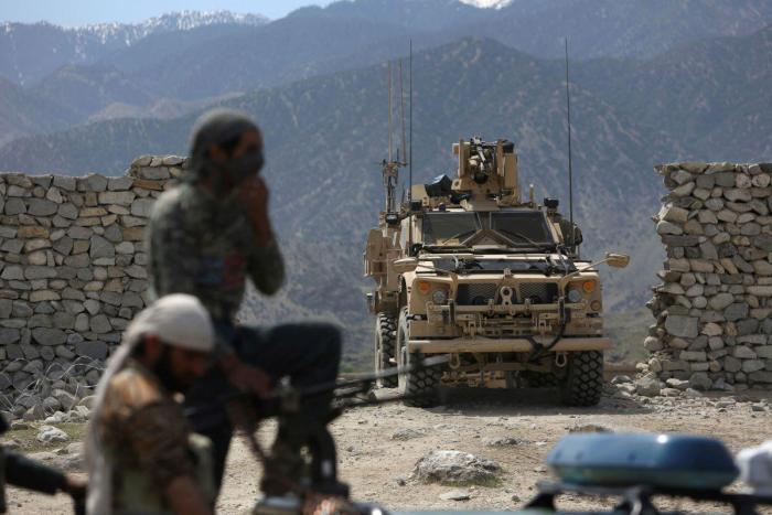 US forces and Afghan security police are seen in Asad Khil, east of Kabul, Afghanistan, Saturday, April 17, 2017. The US military's complicty in abuses in Afghanistan was revealed in papers released in December, 2019