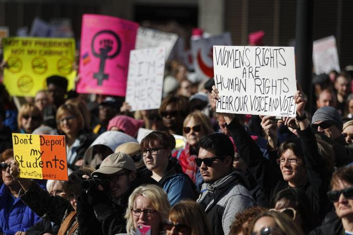 Protesters gather to participate in a Women's March highlighting demands for equal rights and equality for women, Saturday, Jan. 20, 2018, in Cincinnati, Ohio.