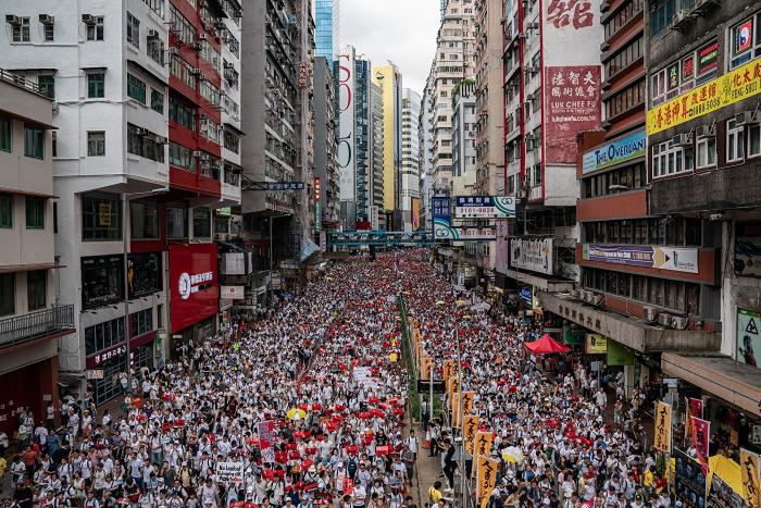 Protesters march on a street during a rally against the extradition law proposal on June 9, 2019 in Hong Kong.