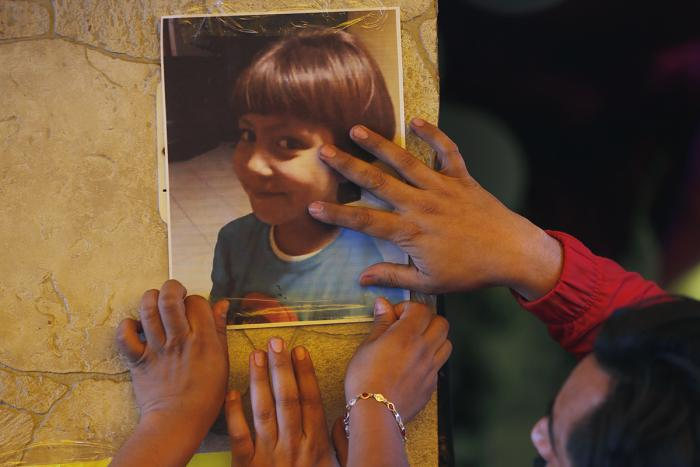Relatives post a photo of Fatima, a 7-year-old girl who was abducted from the entrance of the Enrique C. Rebsamen primary school and later murdered, at her home in Mexico City, February 17, 2020.