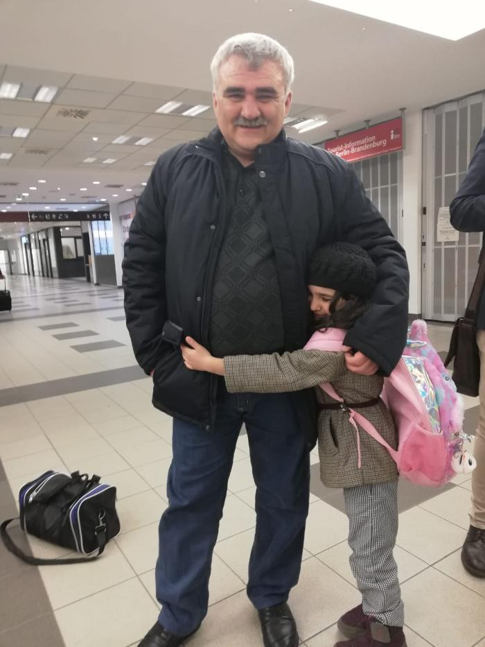 Journalist Afgan Mukhtarli rejoins his daughter in a Berlin airport following his release from prison in Azerbaijan, March 17, 2020.