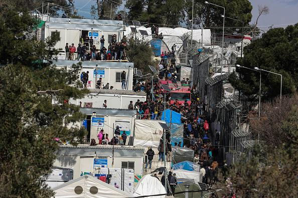 Asylum seekers and migrants in the Reception and Identification Center of Moria, Lesbos after a fire broke out, on March 16, 2020.