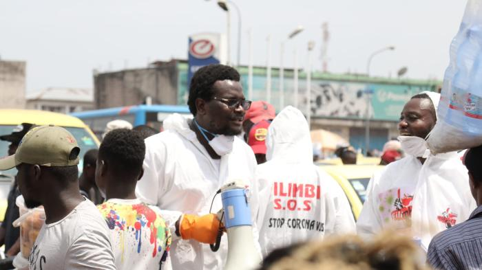 Pro-democracy activists from Filimbi movement raise awareness about the COVID-19 pandemic in Kinshasa's Gambela market, Democratic Republic of Congo, March 28, 2020.