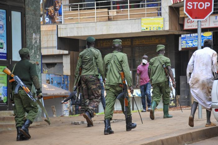 Ugandan police and other security forces chase people off the streets, after police cleared a stand of motorcycle taxis which are no longer permitted to operate after all public transport was banned for two weeks to halt the spread of the new coronavirus,