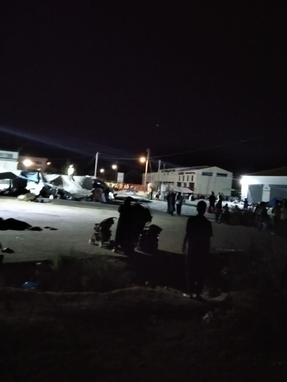 A refugee camp at night