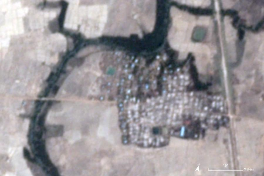 Satellite imagery recorded on May 18, 2020, shows approximately 200 buildings affected by fire in Let Kar village, which likely occurred on May 16 around 2 p.m. local time.