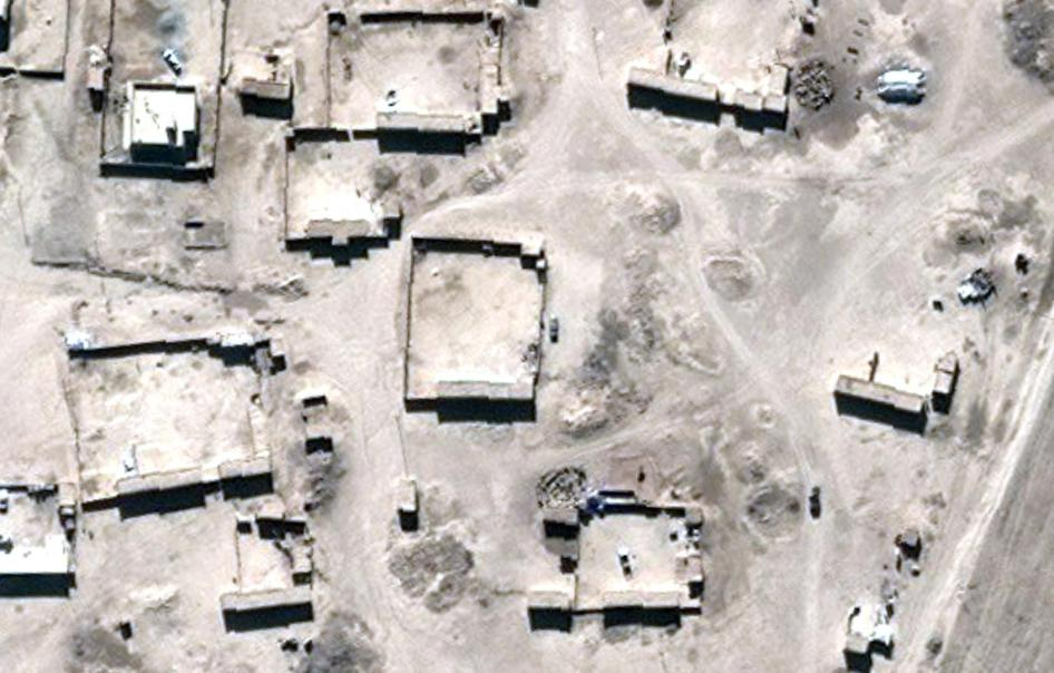 Satellite imagery showing the village of Mashirafat al-Jisr, Iraq, before building demolition.