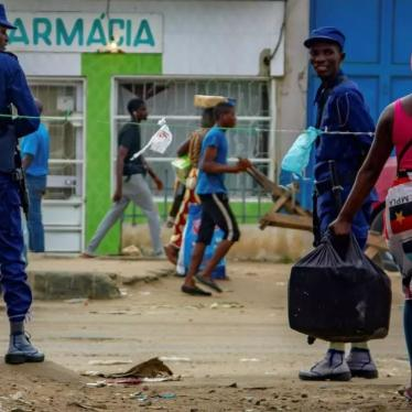 Angolan police patrol streets as people move about during the country's Covid-19 lockdown, Luanda, Angola, March 2020.