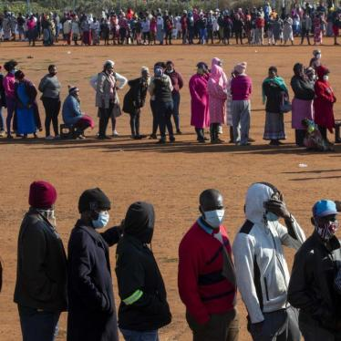 People affected by the coronavirus economic downturn, line up to receive food donations at the Iterileng informal settlement near Laudium, southwest of Pretoria, South Africa, Wednesday, May 20, 2020.