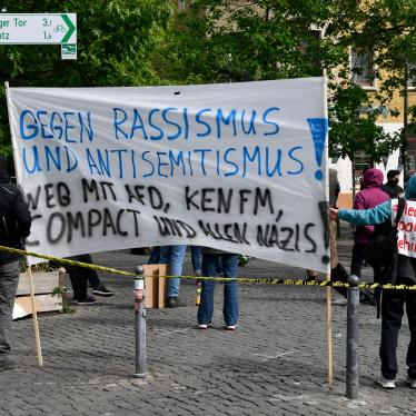 "Calling our racism: Demonstrators gather to oppose messages of discrimination at protests over Covid -19 containment measures. The sign reads ""Against racism and anti-Semitism"". Rosa-Luxemburg Platz, Berlin, 16 May 2020."