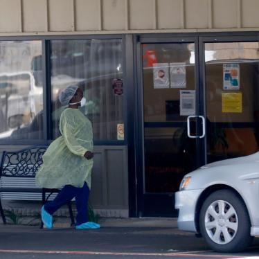 A worker walks in to the Paris Healthcare Center in Paris, Texas, April 29, 2020.