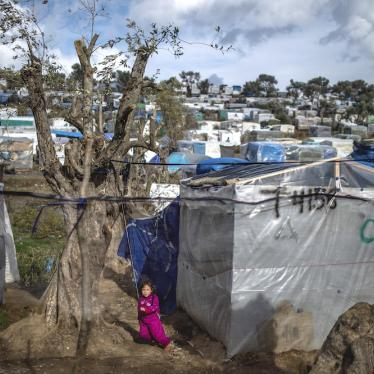A child plays in a temporary tent camp near the camp for migrants in Moria, Lesbos which is overcrowded and lacks adequate hygiene facilities and sanitation, putting migrants, including pregnant people, at particular risk amid Covid-19