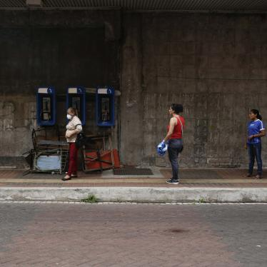 Women practice social distancing as they wait in line to enter a supermarket, on a day that men must stay indoors in Panama City on April 3, 2020.
